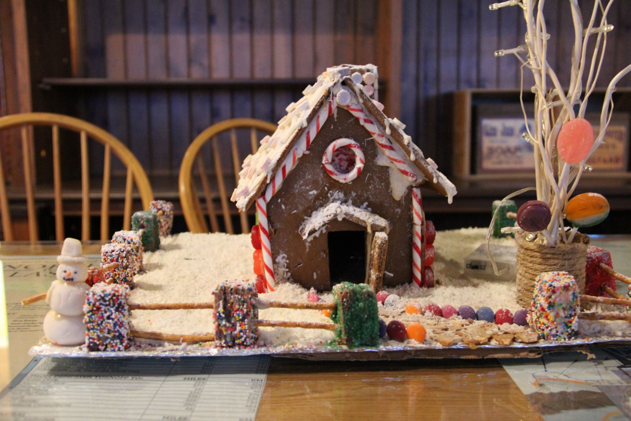Jaden Ezzard's gingerbread cabin with cookie and pretzel fence. Photo Credit: Molly MacDonald