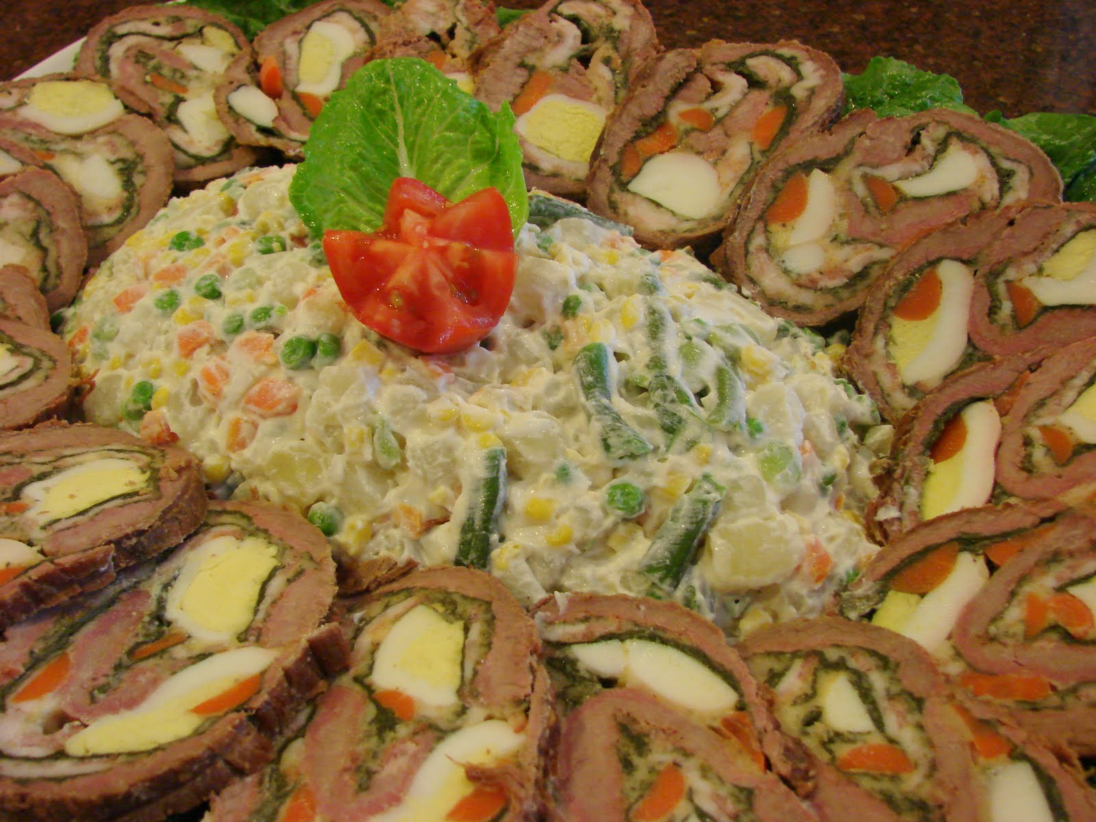 "This is matambre surrounding a ""Russian salad"" glistening with mayo. My mum's is better. Credit: La Nacion"